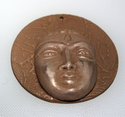 Dried bronze clay devi pendant